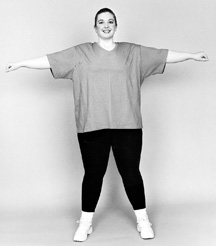 photo of large woman with arms outstretched