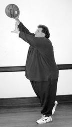photo of large man throwing a basketball