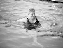 photo of large woman exercising in water