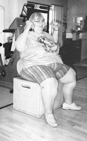 photo of large woman lifting hand weights